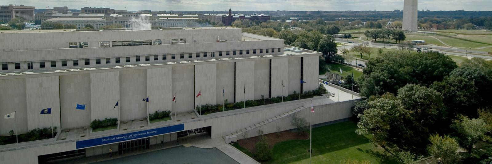 Aerial photo of the National Museum of American History with the Washington National Monument in the background